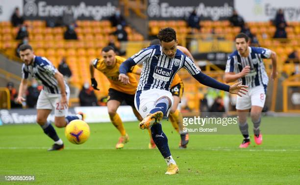 Matheus Pereira of West Bromwich Albion scores a penalty for his team's first goal during the Premier League match between Wolverhampton Wanderers...