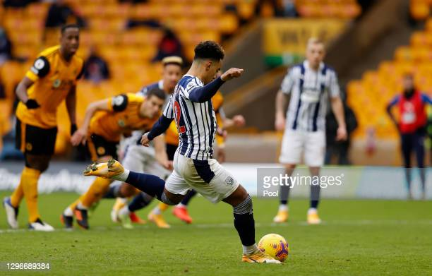 Matheus Pereira of West Bromwich Albion scores a penalty for his team's third goal during the Premier League match between Wolverhampton Wanderers...