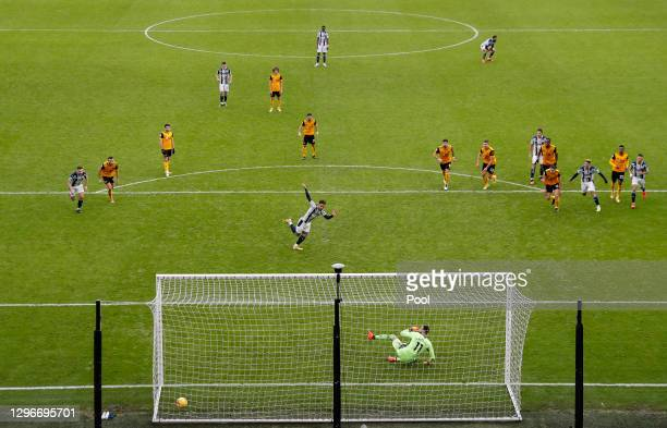 Matheus Pereira of West Bromwich Albion scores a penalty past Rui Patricio of Wolverhampton Wanderers for his team's third goal during the Premier...