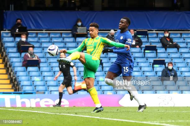 Matheus Pereira of West Bromwich Albion scores their team's first goal under pressure from Kurt Zouma of Chelsea during the Premier League match...