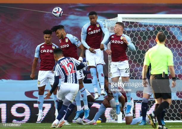 Matheus Pereira of West Bromwich Albion taking a free kick with Ollie Watkins, Tyrone Mings, Ezri Konsa and Ross Barkley in the wall during the...