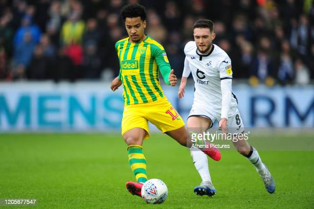 Matheus Pereira of West Bromwich Albion under pressure from Matt Grimes of Swansea City during the Sky Bet Championship match between Swansea City...