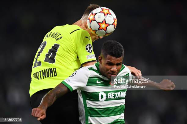 Matheus Reis of Sporting CP competes for a header with Thomas Meunier of Borussia Dortmund during the UEFA Champions League group C match between...