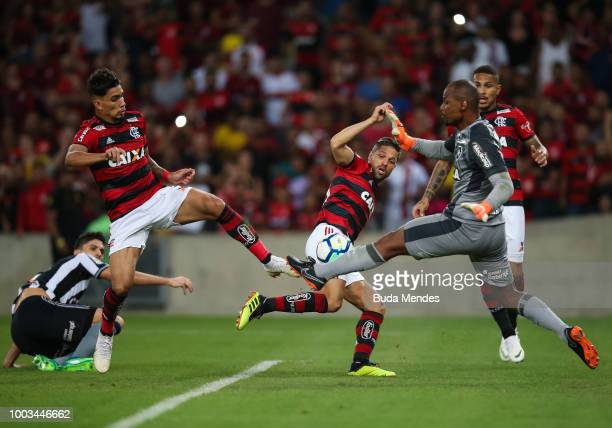 Matheus Savio of Flamengo struggles for the ball with Luis Ricardo of Botafogo during a match between Flamengo and Botafogo as part of Brasileirao...