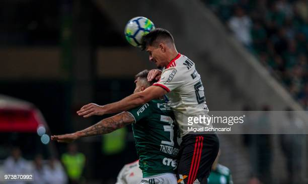 Matheus Thuler of Flamengo scores for a gol with Thiago Martins of Palmeiras during a match between Palmeiras and Flamengo for the Brasileirao Series...