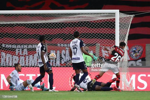 Matheus Thuler of Flamengo scores the first goal of his team during a Group A match of Copa CONMEBOL Libertadores 2020 between Flamengo and Junior at...
