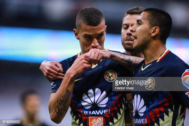 Matheus Uribe of America celebrates with teammate Cecilio Dominguez after scoring the second goal of his team during the 7th round match between...