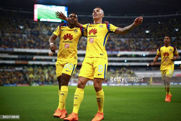 Matheus Uribe of America celebrates with teammates after scoring the first goal of his team during the 13th round match between America and Cruz Azul...