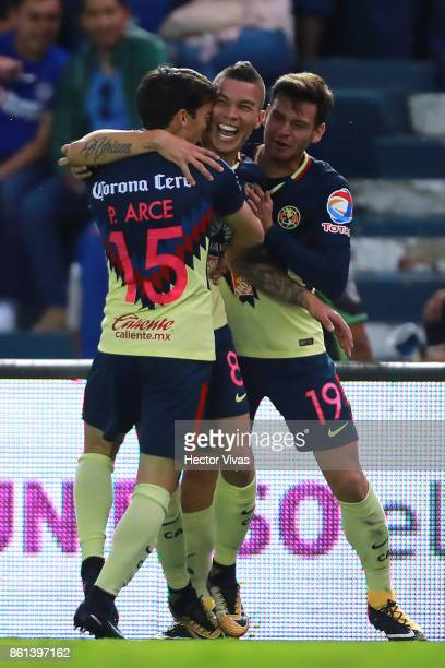 Matheus Uribe of America celebrates with teammates Pedro Arce and Alejandro Díaz after scoring the third goal of his team during the 13th round match...