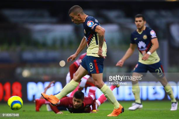 Matheus Uribe of America kicks the ball to score the third goal of his team during the 7th round match between America and Monarcas as part of the...