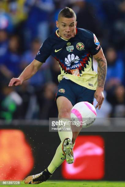 Matheus Uribe of America shoots on target and scores the third goal of his team during the 13th round match between Cruz Azul and America as part of...