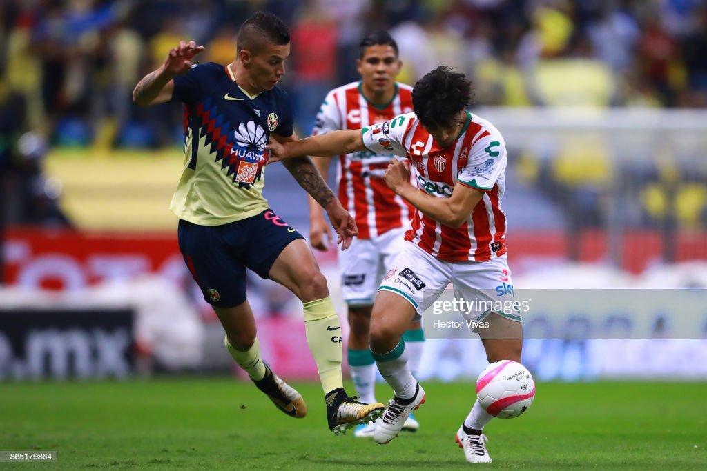 Mateus Uribe of America struggles for the ball with Marcos Gonzalez of Necaxa during the 14th round match between America and Necaxa as part of the Torneo Apertura 2017 Liga MX at Azteca Stadium on October 21, 2017 in Mexico City, Mexico.