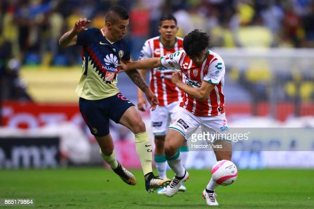 Mateus Uribe of America struggles for the ball with Marcos Gonzalez of Necaxa during the 14th round match between America and Necaxa as part of the...