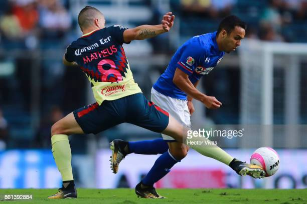 Mateus Uribe of America struggles for the ball with Omar Mendoza of Cruz Azul during the 13th round match between Cruz Azul and America as part of...