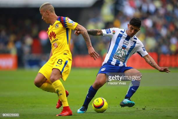 Mateus Uribe of America struggles for the ball with Victor Guzman of Pachuca during the second round match between America and Pachuca as part of the...