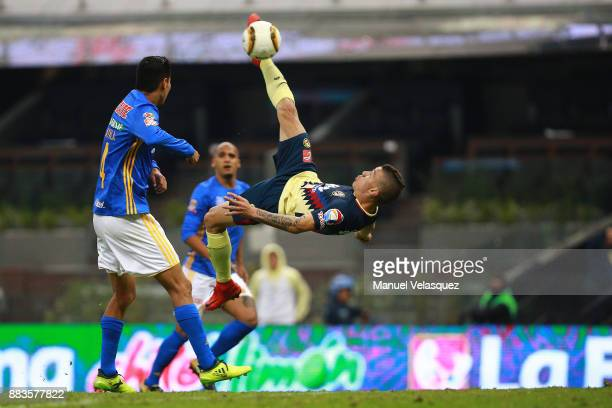 Mateus Uribe of America tries a bycicle shot during the semifinal first leg match between America and Tigres UANL as part of the Torneo Apertura 2017...