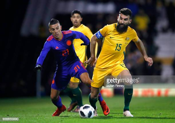 Mateus Uribe of Columbia competes for the ball with Mile Jedinak of Australia during the International friendly between Australia and Colombia at...