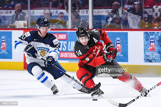 Mathew Barzal of Team Canada skates the puck against Julius Mattila of Team Finland during the IIHF exhibition game at the Bell Centre on December 19...