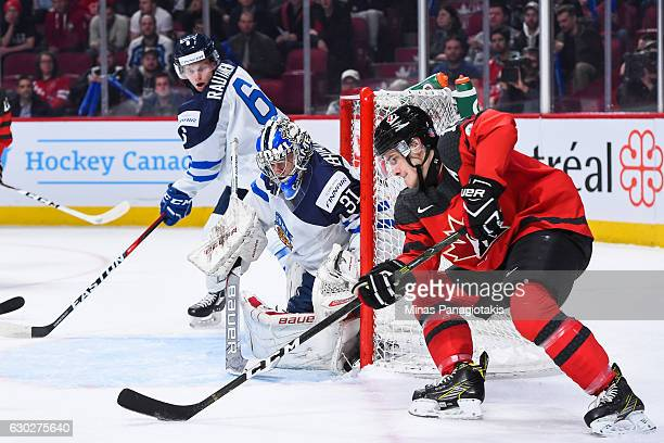Mathew Barzal of Team Canada wraps around the net of goaltender Veini Vehvilainen of Team Finland during the IIHF exhibition game at the Bell Centre...