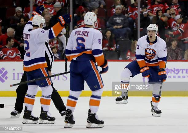 Mathew Barzal of the New York Islanders celebrates his game winning goal in overtime against the New Jersey Devils at Prudential Center on November...