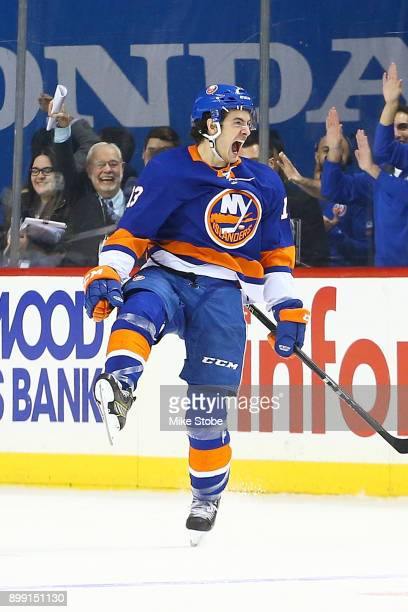 Mathew Barzal of the New York Islanders celebrates his gamewinning goal in overtime against the Buffalo Sabres at Barclays Center on December 27 2017...