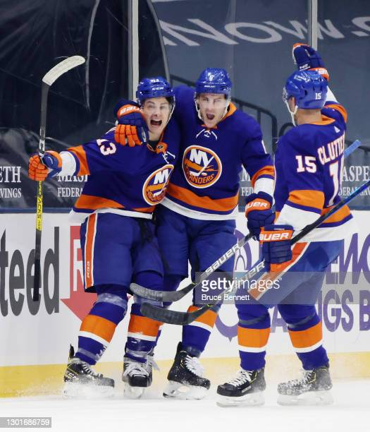Mathew Barzal of the New York Islanders celebrates his goal against the Pittsburgh Penguins at 13:35 of the third period and is joined by Ryan Pulock...