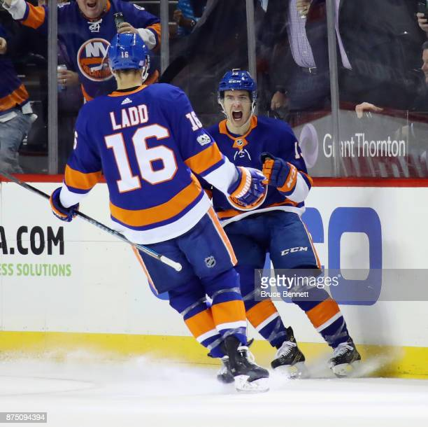 Mathew Barzal of the New York Islanders celebrates his goal at 1621 of the first period against the Carolina Hurricanes and is joined by Andrew Ladd...