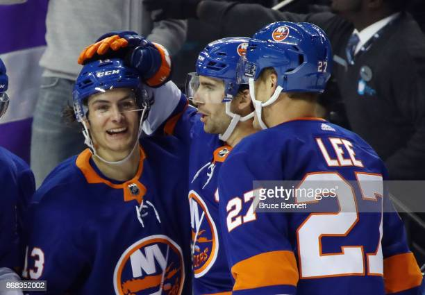 Mathew Barzal of the New York Islanders celebrates his goal at 1744 of the second period against the Vegas Golden Knights and is joined by John...