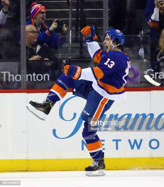 Mathew Barzal of the New York Islanders celebrates his goal at 1924 of the first period against the Winnipeg Jets at the Barclays Center on December...