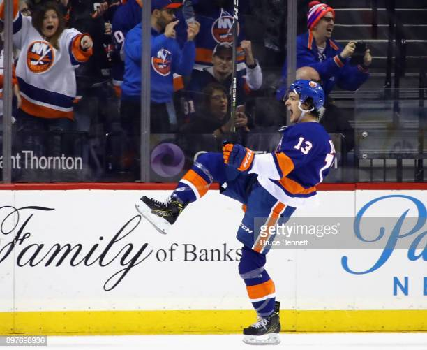 Mathew Barzal of the New York Islanders celebartes his goal at 1924 of the first period against the Winnipeg Jets at the Barclays Center on December...