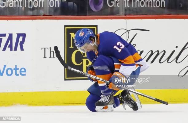 Mathew Barzal of the New York Islanders celebrates his goal at 220 of the first period against the Winnipeg Jets at the Barclays Center on December...