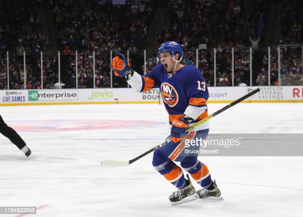 Mathew Barzal of the New York Islanders celebrates his goal at 458 of the second period against the Tampa Bay Lightning at NYCB Live's Nassau...