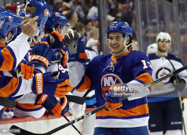 Mathew Barzal of the New York Islanders celebrates his hattrick goal at 1122 of the third period against the Winnipeg Jets at the Barclays Center on...