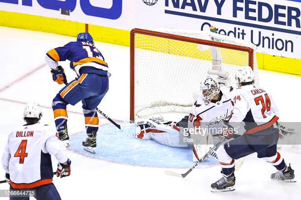 Mathew Barzal of the New York Islanders celebrates scores the game winning goal at 428 past Braden Holtby of the Washington Capitals during the first...