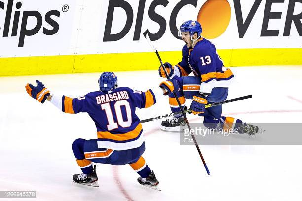 Mathew Barzal of the New York Islanders celebrates with Derick Brassard after scoring the game winning goal at 4:28 against the Washington Capitals...