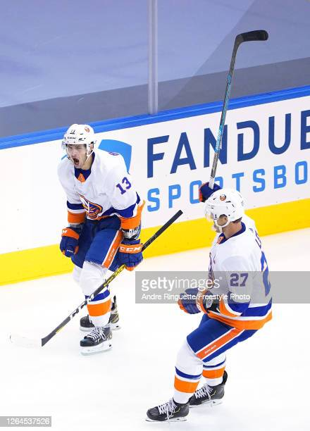 Mathew Barzal of the New York Islanders celebrates with teammate Anders Lee after Barzal scored a goal in the third period against the Florida...