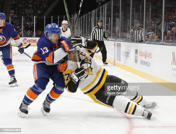 Mathew Barzal of the New York Islanders checks Sidney Crosby of the Pittsburgh Penguins during the third period at NYCB Live at the Nassau Coliseum...