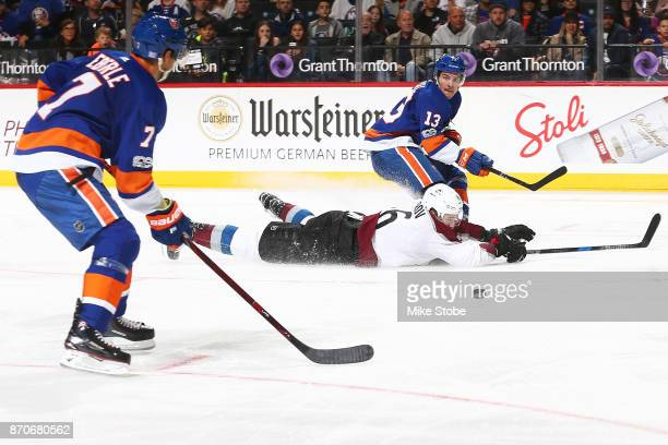 Mathew Barzal of the New York Islanders completes a saucer pass to teammate Jordan Eberle leading to a third period goal against the Colorado...