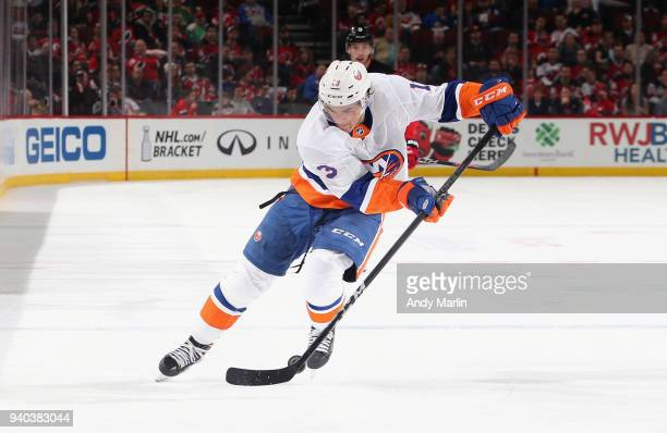 Mathew Barzal of the New York Islanders controls the puck against the New Jersey Devils during the game at Prudential Center on March 31 2018 in...