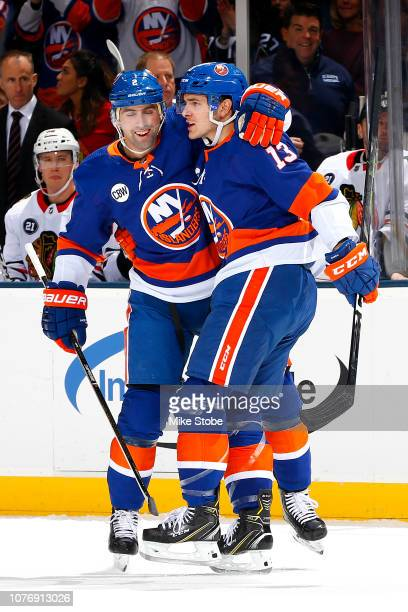 Mathew Barzal of the New York Islanders is congratulated by his teammate Nick Leddy after scoring a first period goal against the Chicago Blackhawks...