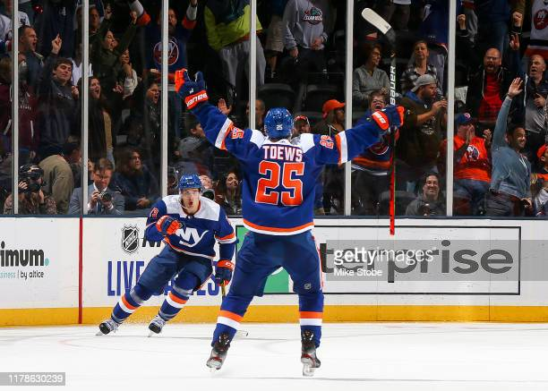 Mathew Barzal of the New York Islanders is congratulated by his teammate Devon Toews after scoring a goal against the Philadelphia Flyers during the...