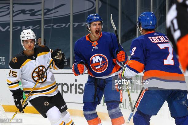 Mathew Barzal of the New York Islanders is congratulated by Jordan Eberle after scoring a goal as Connor Clifton of the Boston Bruins reacts during...