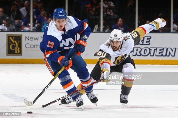 Mathew Barzal of the New York Islanders is pursued by Chandler Stephenson of the Vegas Golden Knights during the first period at NYCB Live's Nassau...