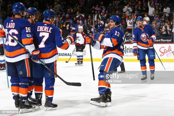 Mathew Barzal of the New York Islanders joins his teammates to celebrate Jordan Eberle's second goal of the game against the Colorado Avalanche at...