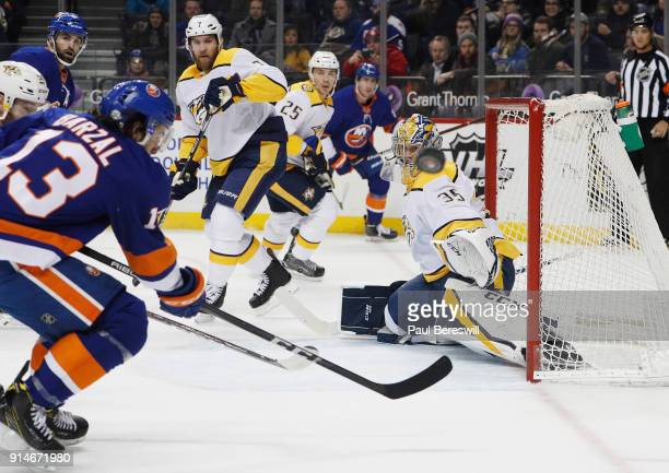 Mathew Barzal of the New York Islanders looks for a rebound off of a save by Pekka Rinne of the Nashville Predators during the first period on...