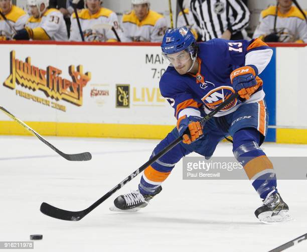 Mathew Barzal of the New York Islanders passes in an NHL hockey game against the Nashville Predators on February 5 2018 at Barclays Center in the...