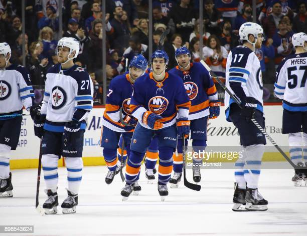 Mathew Barzal of the New York Islanders returns to the bench after scoring one of his three goals against the Winnipeg Jets at the Barclays Center on...