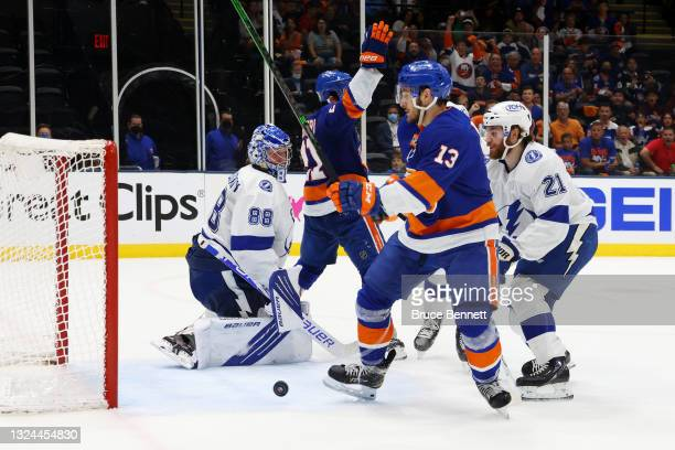 Mathew Barzal of the New York Islanders scores a goal on Andrei Vasilevskiy of the Tampa Bay Lightning during the second period in Game Four of the...