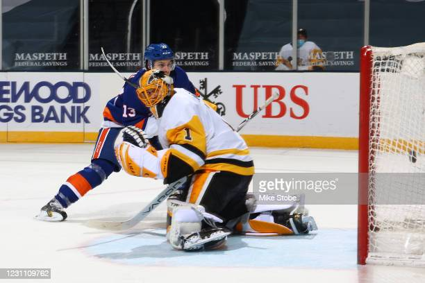 Mathew Barzal of the New York Islanders scores a goal past Casey DeSmith of the Pittsburgh Penguins during the third period at Nassau Coliseum on...