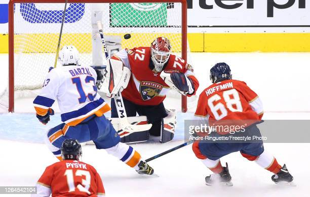 Mathew Barzal of the New York Islanders scores as he gets the puck past Sergei Bobrovsky of the Florida Panthers in the third period in Game Four of...